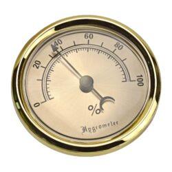 Vlhkoměr Angelo, 74mm-Standardní vlhkoměr Angelo do humidoru. Vhodný do středních nebo větších humidorů. Provedení: zlaté. Vnější průměr: 74 mm Vnitřní průměr pro vložení: 55 mm