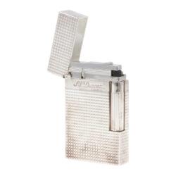 Zapalovač S.T. DuPont Ligne 2 plate care, stříbrný-Luxusní plynový zapalovač S.T. DuPont Ligne 2 známé francouzské značky. Zapalovač z elegantní řady Ligne 2, pro kterou je typický a lehce identifikovatelný ping zvuk při otevření zapalovače. Dokonale zpracovaný kovový kamínkový zapalovač, který skvěle kombinuje funkci a elegantní vzhled. Zapalovač umožňuje nastavit dva druhy plamene a to pro kuřáky cigaret a doutníků nebo pro kuřáky dýmky. Na boku najdeme škrtací mechanismus. Ve spodní části najdeme plnící ventil plynu a ovládání intenzity plamene. Kamínek se mění v horní části zapalovače. Zapalovač je dodáván v dárkové krabičce vyložené jemným sametem. Výška 6cm. Vyrobeno ve Francii.